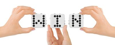 Hands and dices Win Stock Image