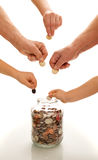 Hands of different generations saving coins stock photo