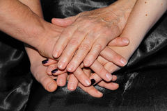Hands of different generations Stock Image