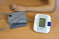 Hands and digital blood pressure measurement Royalty Free Stock Photography