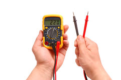 Hands with a digital multimeter on a white. Background stock images