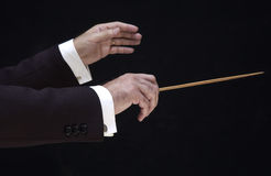 Hands of the director. Hands of the conductor, on black background royalty free stock images