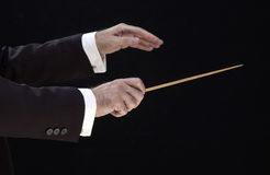 Hands of the director. Hands of the conductor, on black background stock photography