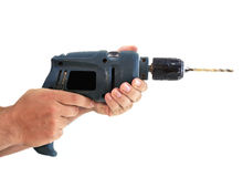 Hands with a dirty electric drill Stock Photo