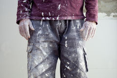 Hands dirty trousers of plastering painter man. Hands and white dirty trousers detail of plastering painter man Stock Photography