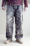 Hands dirty trousers of plastering painter man Stock Images