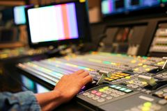 Hands on dissolve of Switcher buttons in studio TV station, Audi royalty free stock photos