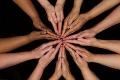 Prayer Hands of diversity women working cooperatively hands in hearts