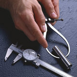 Hands with Divider and Caliper Tightly Cropped Royalty Free Stock Images