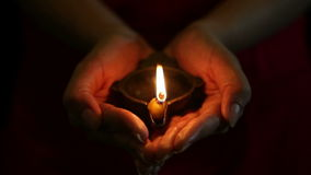 Hands with Diwali oil lamp Royalty Free Stock Images