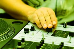 Hands of a dj adjusting the crossfader Royalty Free Stock Photo
