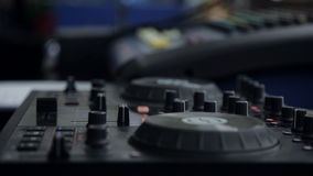 Hands DJ behind the decks stock video