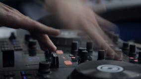 Hands DJ behind the decks stock video footage