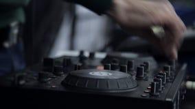 Hands DJ behind the decks stock footage
