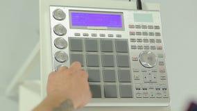 Hands of dj controlling digital music on mixer stock video