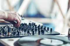 Hands of DJ mixing music. Close up on hands of DJ mixing music on sound board stock photos