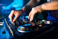 Hands DJ music mixer is managing the volume. And mix music Royalty Free Stock Image