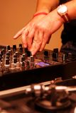 Hands of a Dj playing music Stock Photography