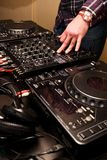 Hands of a Dj playing music Stock Photos