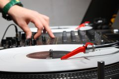 Hands of a DJ playing music from vinyl Stock Images