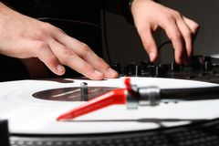 Hands of a DJ playing music from vinyl Royalty Free Stock Images
