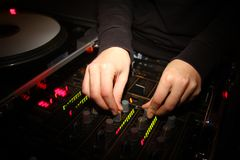 Hands of a DJ playing in the nightclub Stock Photo