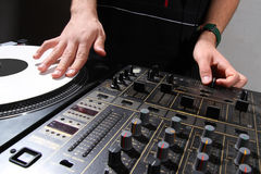 Hands of DJ scratching vinyl record Stock Photography