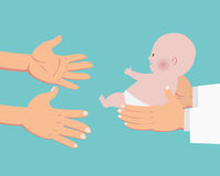 Hands of doctor giving a baby to parents hands Stock Photography