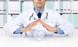 Hands doctor with heart beat icon stock photo
