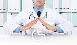 Hands doctor protect wheelchair symbol stock images