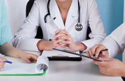 Hands of doctors with clipboards Royalty Free Stock Photo