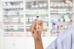 Hands the doctors filling a syringe on store medicine and pharmacy drugstore for background stock image