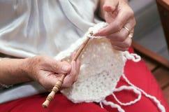Hands doing crochet stock images