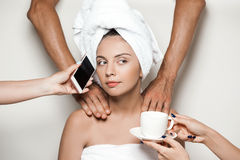 Hands doing massage, giving phone and coffee to beautiful girl. Royalty Free Stock Photos