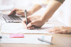 Hands doing paperwork and using laptop Royalty Free Stock Images