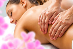 Hands doing Relaxing back massage. Stock Photography