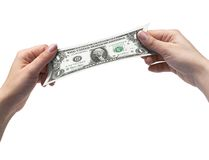 Hands and Dollar. Female hands stretching a one dollar bill royalty free stock photography