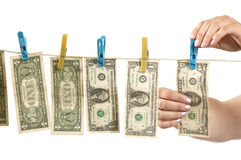 Hands and dollars Stock Photos