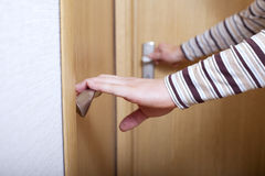 Hands and doors. Royalty Free Stock Photos