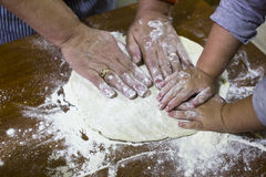 Hands in dough Stock Photography