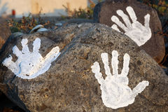 Hands draw. Three hands draw on a stone royalty free stock photos