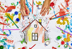 Hands draw house. Top view of hands drawing house colorful concept royalty free stock photo