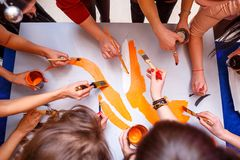 Hands draw on the poster, the concept of teamwork stock photo