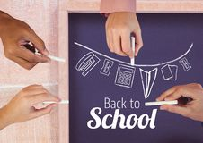 Hands drawing back to school text and stationery on blackboard royalty free illustration