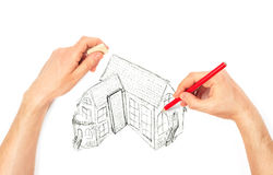Hands drawing big house on a white Royalty Free Stock Images