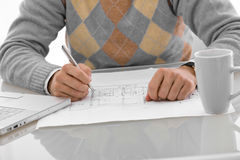 Hands drawing blueprint Royalty Free Stock Photography