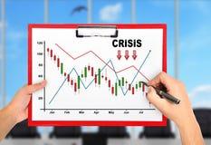 Hands drawing crisis chart Royalty Free Stock Photos