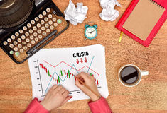 Hands drawing crisis stock chart Royalty Free Stock Photography