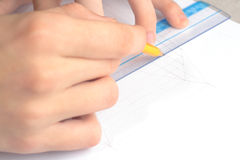 Hands drawing line. Students hands drawing blueprints with pencil and ruler Royalty Free Stock Photography