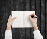 Hands drawing in notebook Royalty Free Stock Images